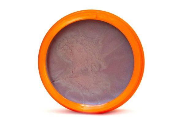 Brown Sun tanning cream inside container